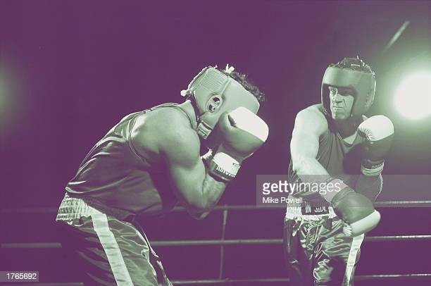Boxing male boxer punching opponent