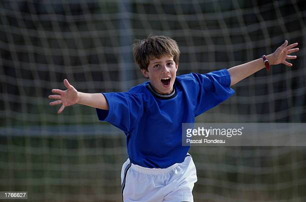 Boy celebrating soccer goal