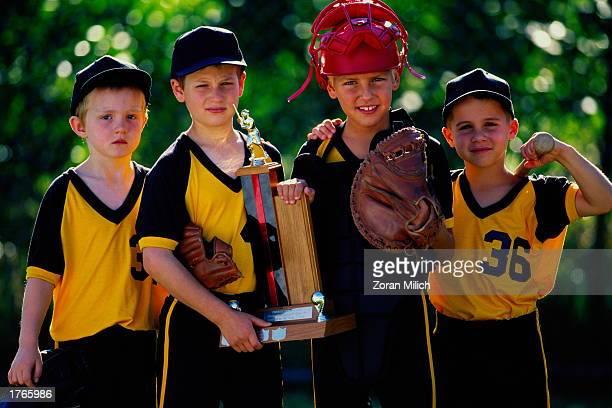 Boys'' baseball team holding trophy portrait