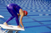 Female competitive swimmer poised on starting block