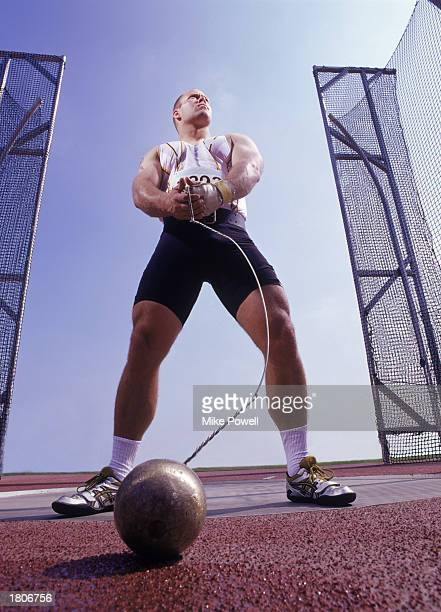 Male hammer thrower preparing for throw in competition low angle view