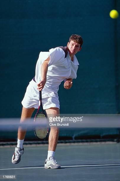 Man playing tennis net in foreground