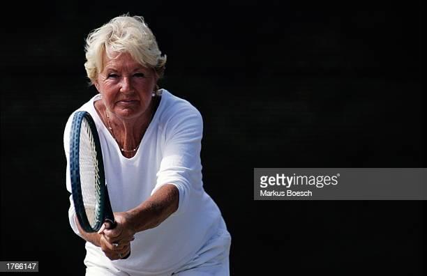 Mature female tennis player