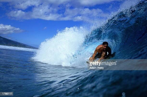 Surfer in tube wave