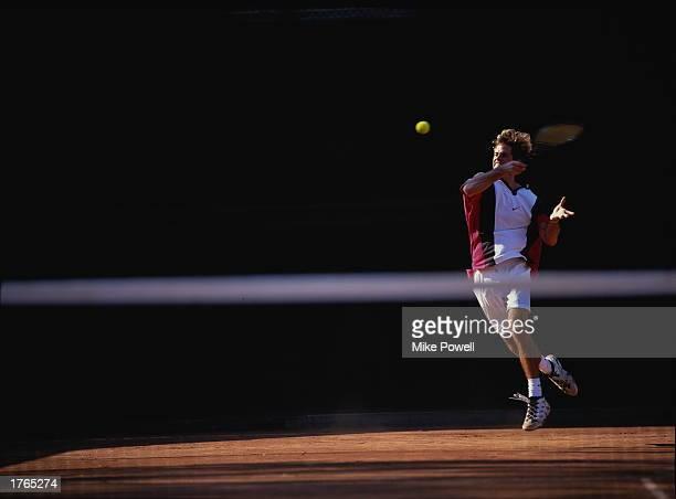 Tennis male player striking ball
