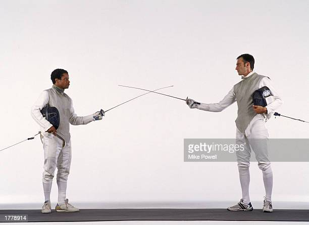 Two male fencers at beginning of bout