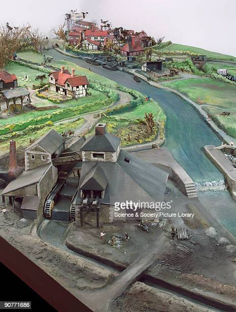 Model representing an 18thcentury British landscape in the foreground is a charcoal burning factory or possibly an ironworks Behind coal is unloaded...