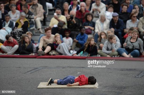 TOPSHOT A model representing the dead Syrian refugee child Aylan Kurdi is pictured during the show called 'miniatures' of the French mechanical...