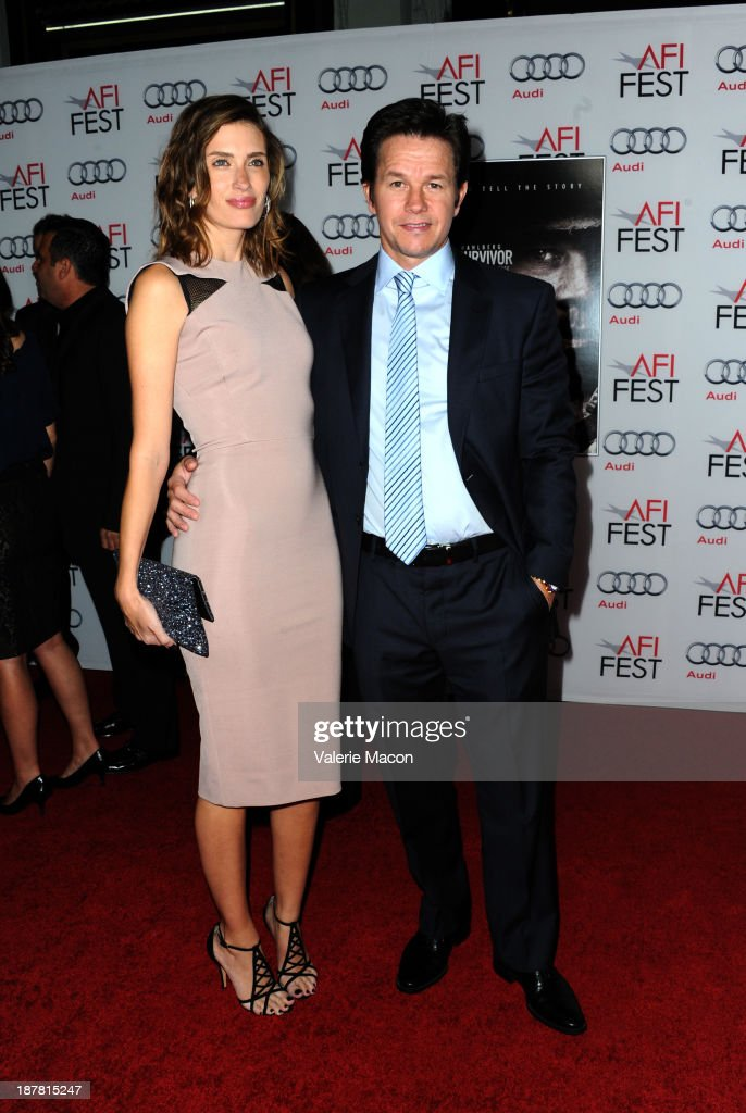 Model Rhea Durham and Actor Mark Wahlberg attend the premiere for 'Lone Survivor' during AFI FEST 2013 presented by Audi at TCL Chinese Theatre on...