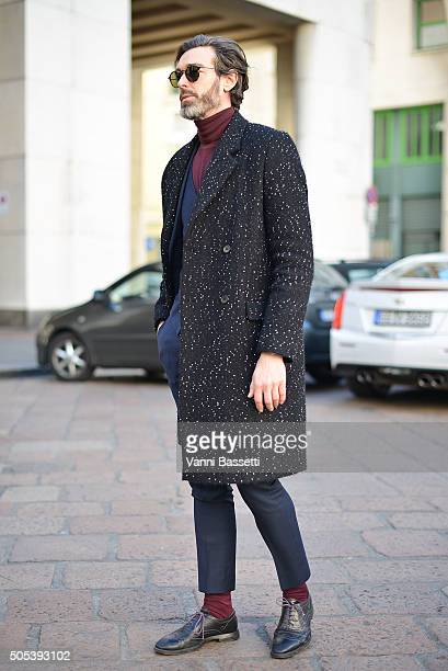 Model Richard Biedul poses wearing a Whistles coat after the Ferragamo show during the Milan Men's Fashion Week Fall/Winter 2016/17 on January 17...