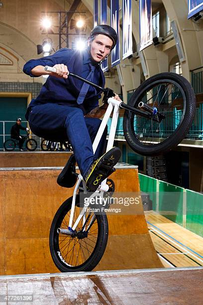 A model rides a BMX during the Jimmy Choo presentation during The London Collections Men SS16 at Seymour Liesure Centre on June 15 2015 in London...