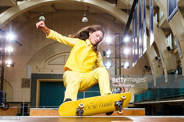 A model rides a skateboard during the Jimmy Choo presentation during The London Collections Men SS16 at Seymor Leisure Centre on June 15 2015 in...