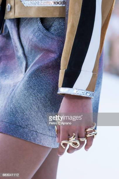 A model ring detail showcases the design on runway during the Louis Vuitton Resort 2018 show at the Miho Museum on May 14 2017 in Koka Japan