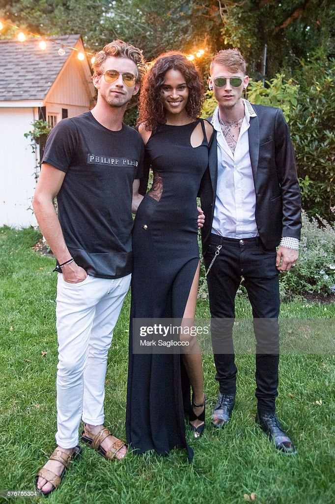 Model RJ King Model Cindy Bruna and Rapper Machine Gun Kelly attend Daily Front Row's Philipp Plein Dinner on July 16 2016 at the Maidstone in East...