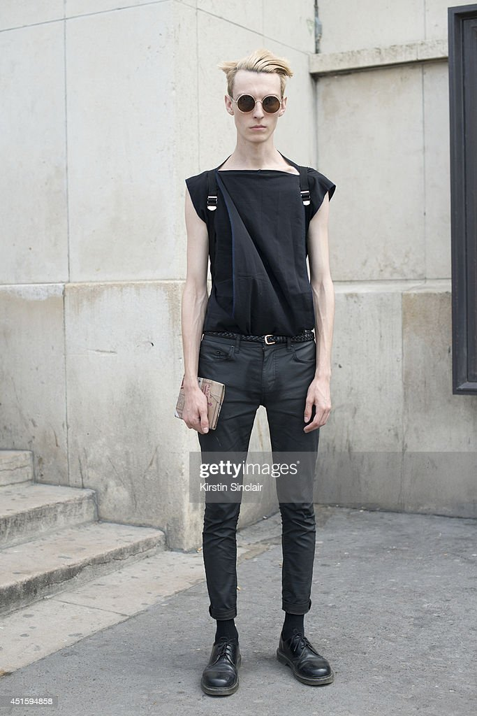 Model Roma Shazuk wearing his own design T shirt, Topshop trousers, Doc Martins shoes and vintage sunglasses on day 2 of Paris Collections: Men on June 26, 2014 in Paris, France.
