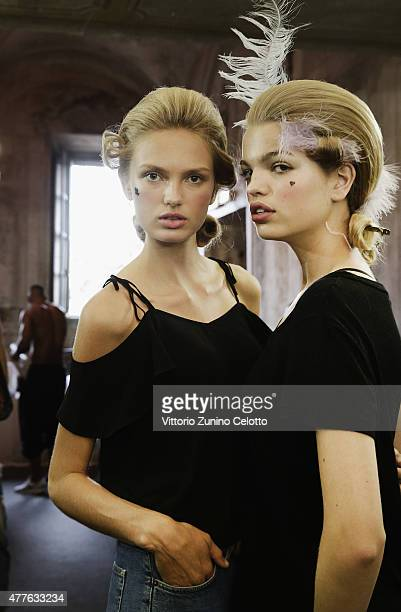 Model Romee Strijd and Daphne Groeneveld pose backstage prior to the Moschino Men's Fashion Show Spring/Summer 2016 during the 88 Pitti Uomo on June...