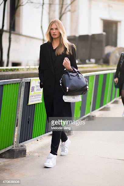 Model Romee Strijd exits the Barbara Bui show in a Givenchy bag and Adidas sneakers at Palais de Tokyo on Day 3 of Paris Fashion Week FW15 on March 5...