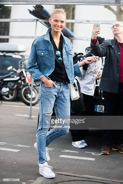 Model Romee Strijd exits the Isabel Marant show at Palais de Tokyo in a all denim outfit and Adidas sneakers on March 6 2015 in Paris France
