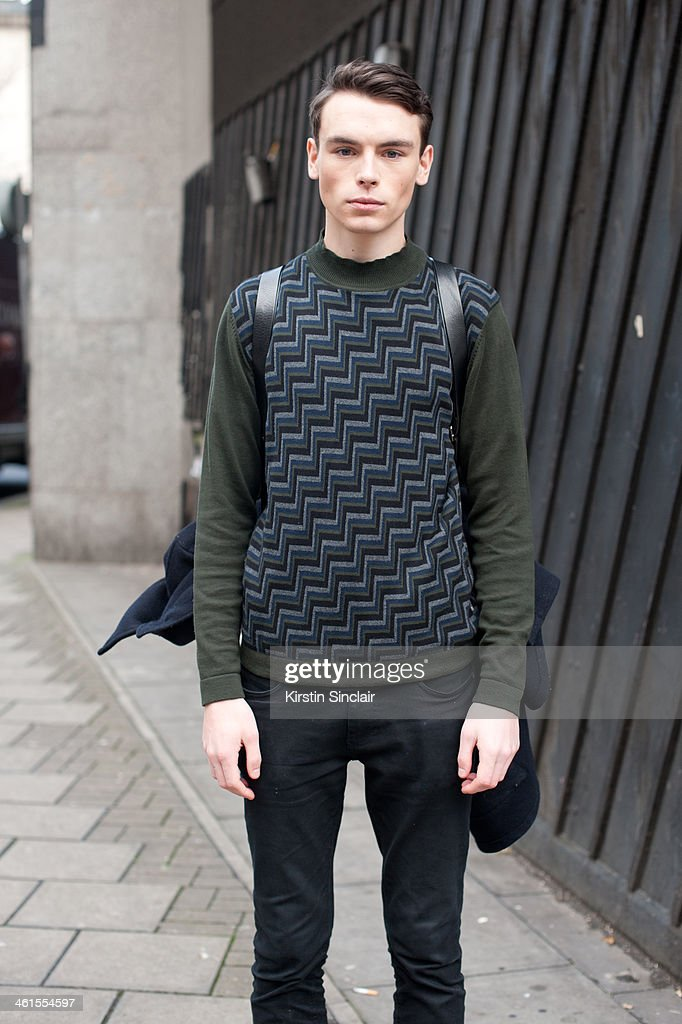 Model Rory Smith wears a Peter Werth top and a Cos bag day 3 of London Mens Fashion Week Autumn/Winter 2014, on January 08, 2014 in London, England.
