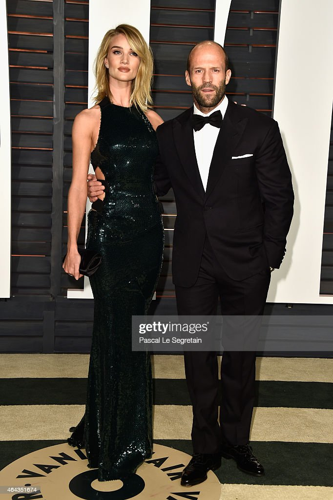 Model Rosie Hiuntington-Whiteley and actor Jason Statham attend the 2015 Vanity Fair Oscar Party hosted by Graydon Carter at Wallis Annenberg Center for the Performing Arts on February 22, 2015 in Beverly Hills, California.