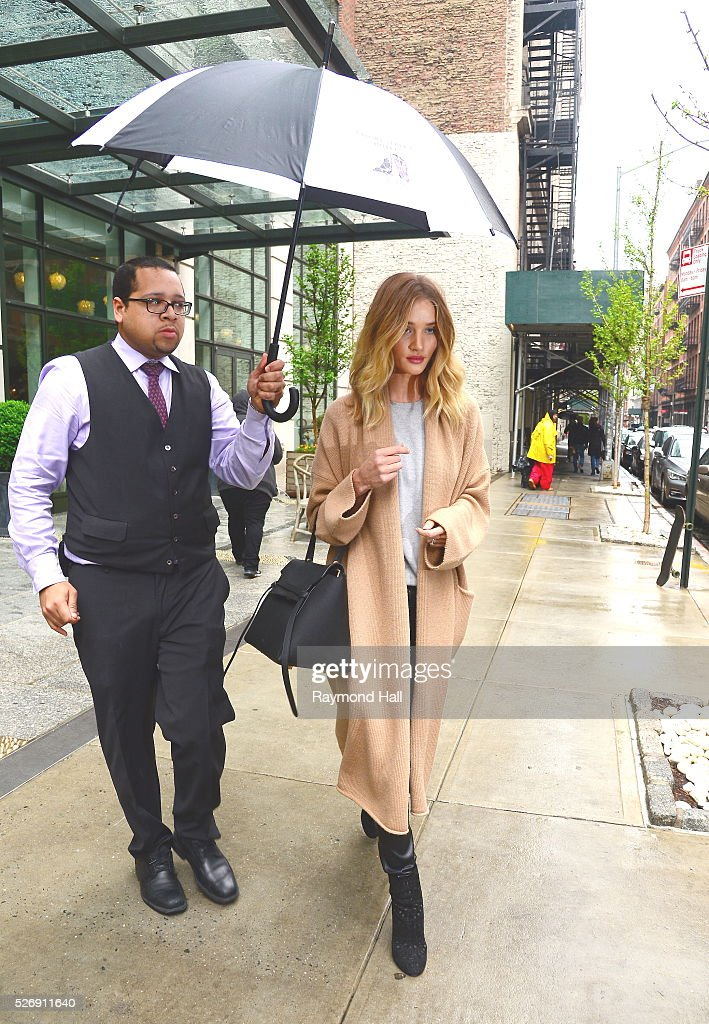Model Rosie Huntington is seen walking in the rain in 'Soho' on May 1, 2016 in New York City.