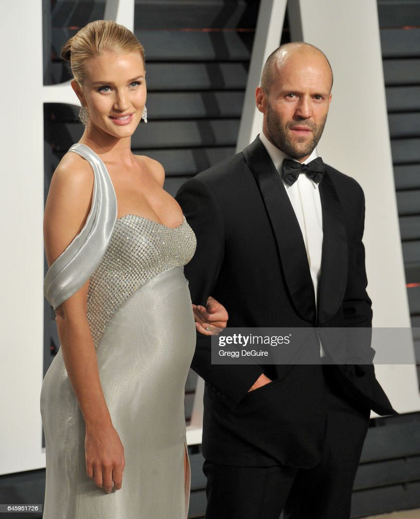 Model Rosie Huntington-Whiteley and actor Jason Statham arrive at the 2017 Vanity Fair Oscar Party Hosted By Graydon Carter at Wallis Annenberg Center for the Performing Arts on February 26, 2017 in Beverly Hills, California.
