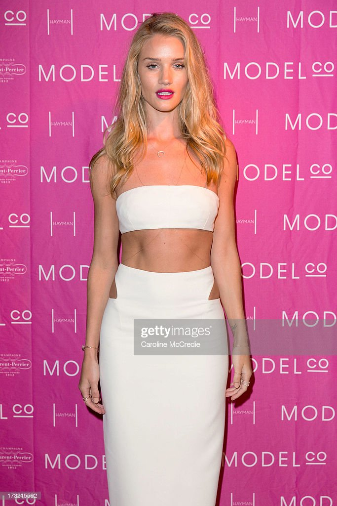 Model <a gi-track='captionPersonalityLinkClicked' href=/galleries/search?phrase=Rosie+Huntington-Whiteley&family=editorial&specificpeople=2244343 ng-click='$event.stopPropagation()'>Rosie Huntington-Whiteley</a> arrives at a black tie dinner hosted by ModelCo on Hayman Island in celebration of their new celebrity ambassador signing, <a gi-track='captionPersonalityLinkClicked' href=/galleries/search?phrase=Rosie+Huntington-Whiteley&family=editorial&specificpeople=2244343 ng-click='$event.stopPropagation()'>Rosie Huntington-Whiteley</a> on July 10, 2013 in Hayman Island, Australia.