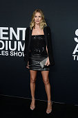 Model Rosie HuntingtonWhiteley arrives at the Saint Laurent show at the Hollywood Palladium on February 10 2016 in Los Angeles California