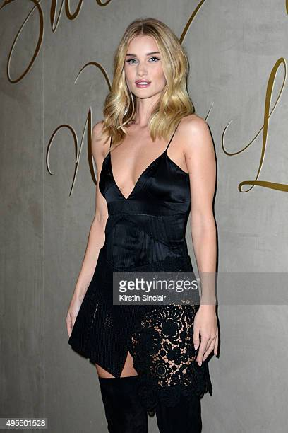 Model Rosie HuntingtonWhiteley arrives for the premiere of the Burberry festive film at Burberry on November 3 2015 in London England