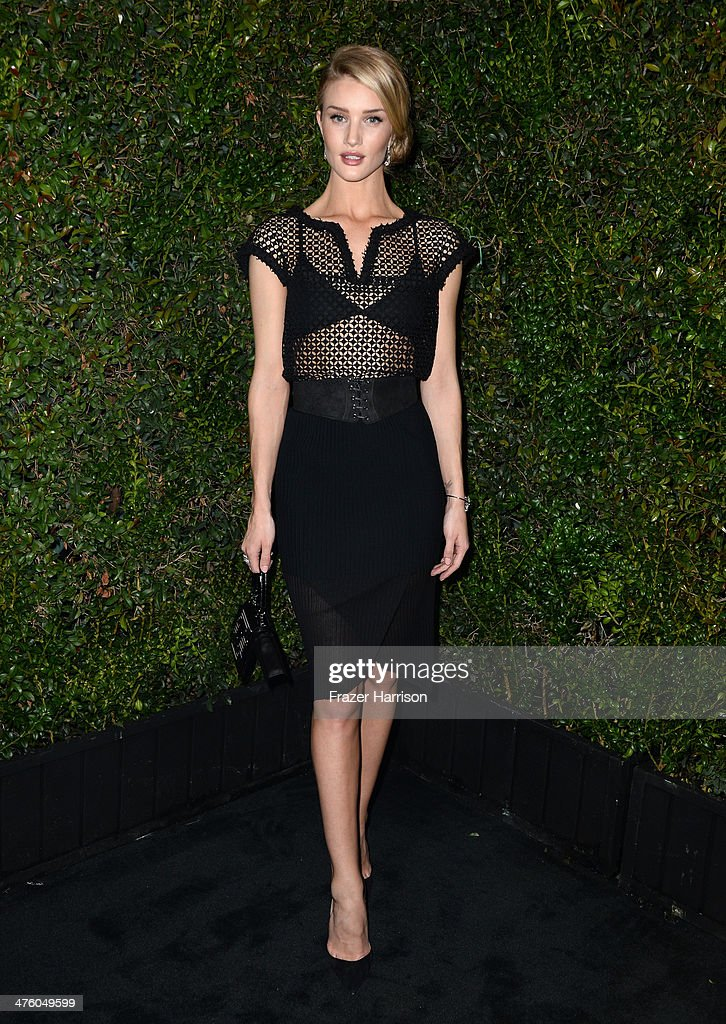 Model Rosie Huntington-Whiteley attends the Chanel and Charles Finch Pre-Oscar Dinner at Madeo Restaurant on March 1, 2014 in Los Angeles, California.