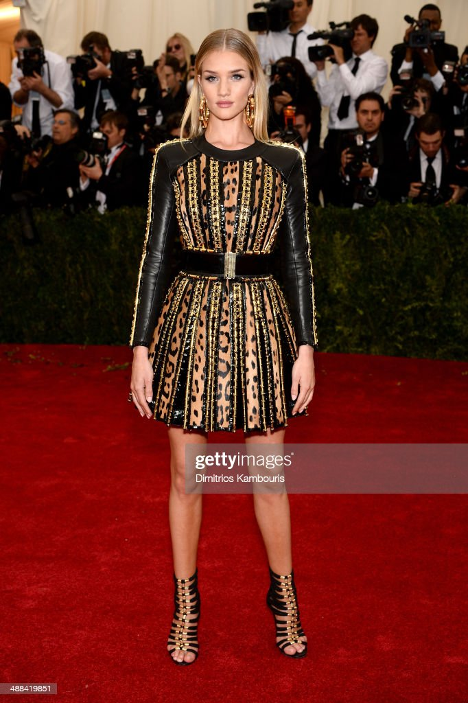 Model Rosie HuntingtonWhiteley attends the 'Charles James Beyond Fashion' Costume Institute Gala at the Metropolitan Museum of Art on May 5 2014 in...