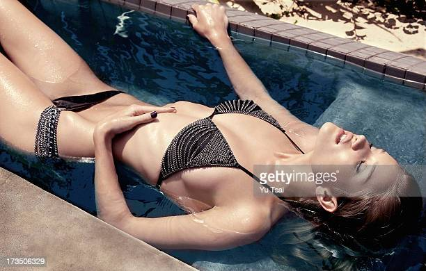 Model Rosie HuntingtonWhiteley is photographed for Beach Bunny on July 26 2009 in Los Angeles California