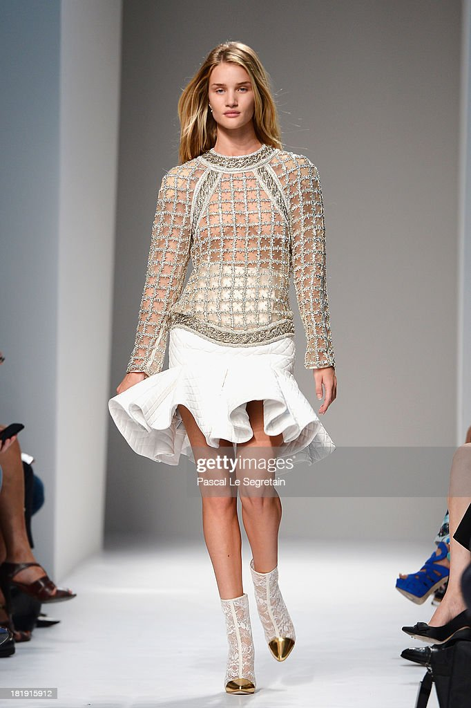 Model <a gi-track='captionPersonalityLinkClicked' href=/galleries/search?phrase=Rosie+Huntington-Whiteley&family=editorial&specificpeople=2244343 ng-click='$event.stopPropagation()'>Rosie Huntington-Whiteley</a> walks the runway during Balmain show as part of the Paris Fashion Week Womenswear Spring/Summer 2013 at Grand Hotel Intercontinental on September 26, 2013 in Paris, France.