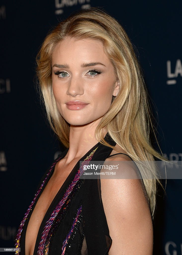 Model Rosie Huntington-Whiteley, wearing Gucci, attends the LACMA 2013 Art + Film Gala honoring Martin Scorsese and David Hockney presented by Gucci at LACMA on November 2, 2013 in Los Angeles, California.