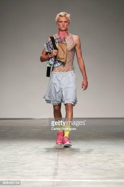 Model runs the catwalk for designer Filipe Augusto during Sangue Novo contest runway show on October 6 2017 in Lisboa CDP Portugal