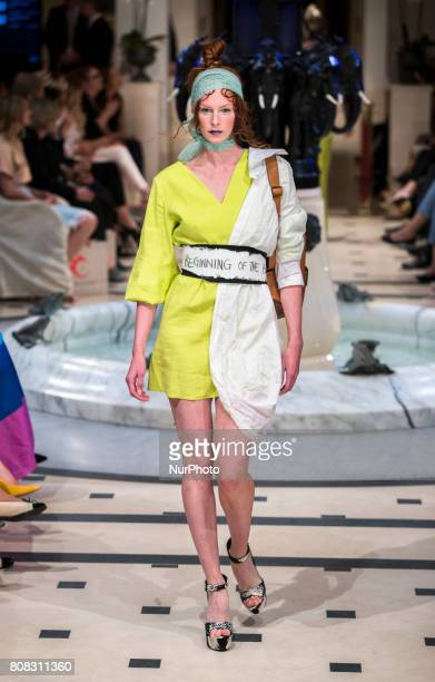 A model runs the runway at Anja Gockel fashion show during MercedesBenz Berlin Fashion Week Spring/Summer 2018 at Adlon Hotel in Berlin Germany on...
