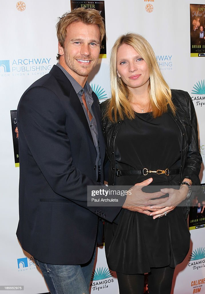Model Rusty Joiner (L) and his wife Charity Walden (R) attend the launch party for Brian Edwards' new book 'Enter Miss Thang' at Cafe Habana on October 21, 2013 in Malibu, California.