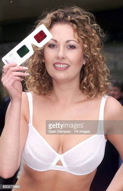 Model Ruth Anderson in London's Oxford Street holds a pair of 3D glasses while wearing Charnos' Bioform Bra at the launch of the company's UK 3D...