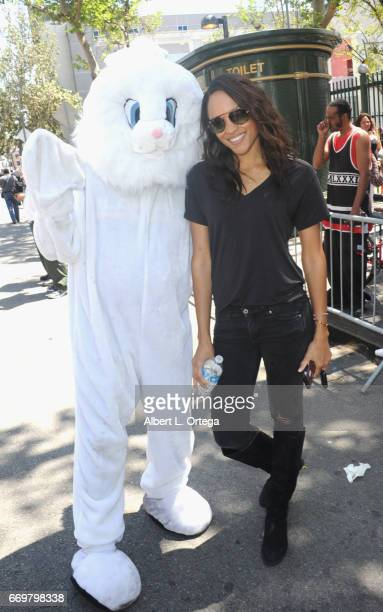 Model Sal Stowers poses with the Easter Bunny at the Los Angeles Mission's Easter Celebration held at Los Angeles Mission on April 14 2017 in Los...