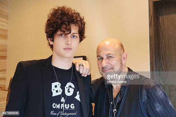 Model Sam Evans poses for a photo with designer John Varvatos before walking in the John Varvatos fashion show at The Roxy Hotel during New York...