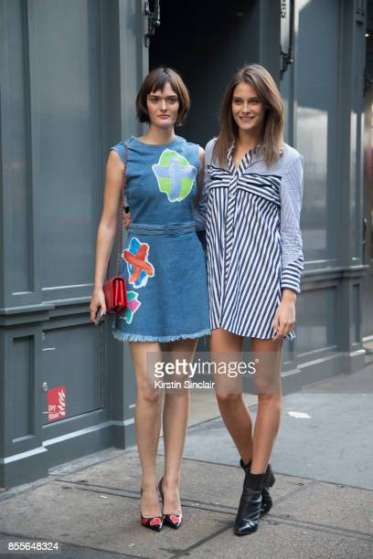 Model Sam Rollinson wears a Henry Holland dress Chanel bag and Prada shoes with Model xcwearing a Henry Holland dress on day 2 of London Womens...