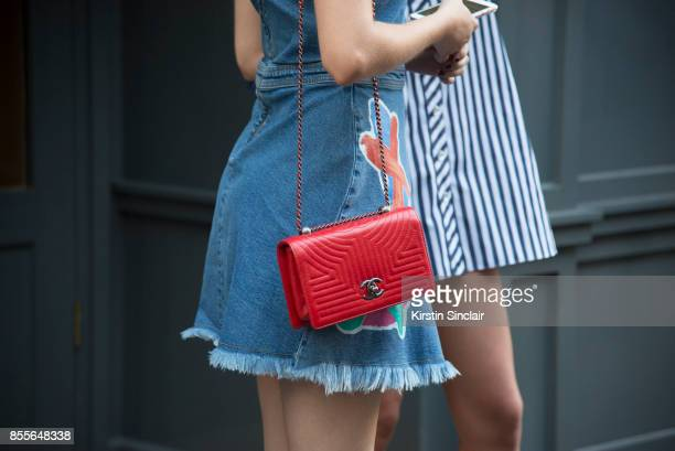 Model Sam Rollinson wears a Henry Holland dress Chanel bag on day 2 of London Womens Fashion Week Spring/Summer 2018 on September 16 2017 in London...