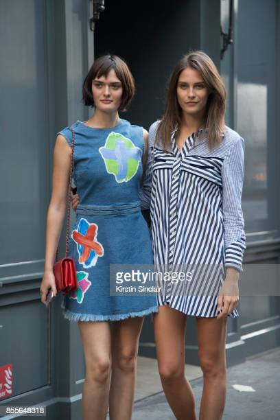 Model Sam Rollinson wears a Henry Holland dress Chanel bag with Model xcwearing a Henry Holland dress on day 2 of London Womens Fashion Week...