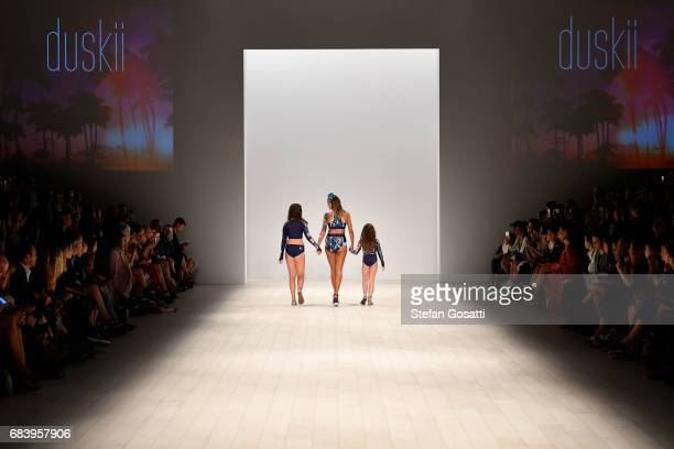 Model Samantha Harris walks the runway in a design by duskii during the Swim show at MercedesBenz Fashion Week Resort 18 Collections at Carriageworks...