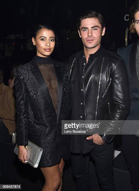 Model Sami Miro in Saint Laurent by Hedi Slimane and actor Zac Efron attend Saint Laurent at the Palladium on February 10 2016 in Los Angeles...