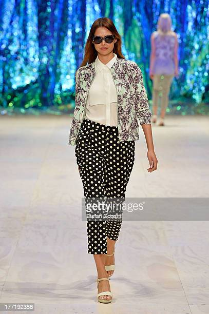 Model Sammantha Harris showcases designs by Sortscraft on the runway at the Sportscraft show during MercedesBenz Fashion Festival Sydney 2013 at...