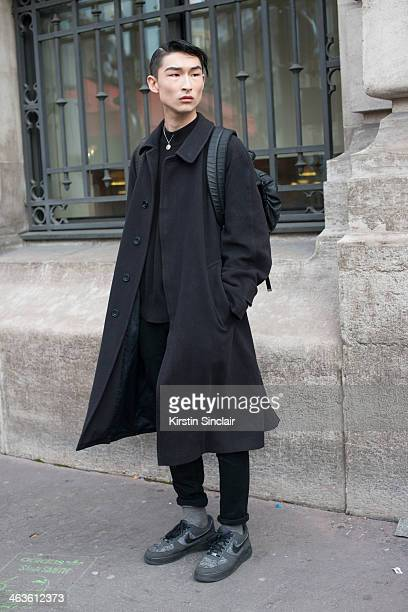 Model Sang Kim wearing a Daks coat Nike trainers vintage YSL jumper Levis jeans and a Juan Jaay collaboration for X beanpole bag day 4 of Paris Mens...