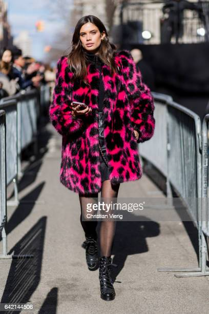Model Sara Sampaio wearing a pink black leoprint coat outside Marc Jacobs on February 16 2017 in New York City