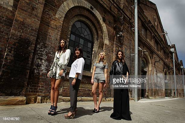 Model Sarah Burns Designer Lisa Ho Model Chelsea Trotter and Designer Kym Ellery pose at Carriageworks on October 17 2012 in Sydney Australia IMG...