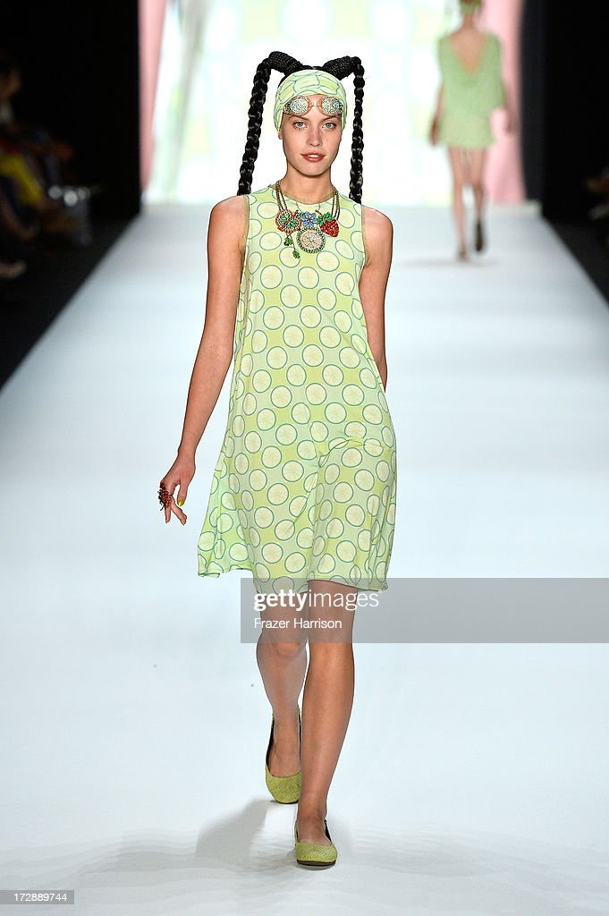 Model Sarah-Anessa Hitzschke walks the runway at the Miranda Konstantinidou Show during the Mercedes-Benz Fashion Week Spring/Summer 2014 at Brandenburg Gate on July 5, 2013 in Berlin, Germany.